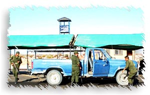 Military Checkpoint guards inspecting a truck outside san felipe